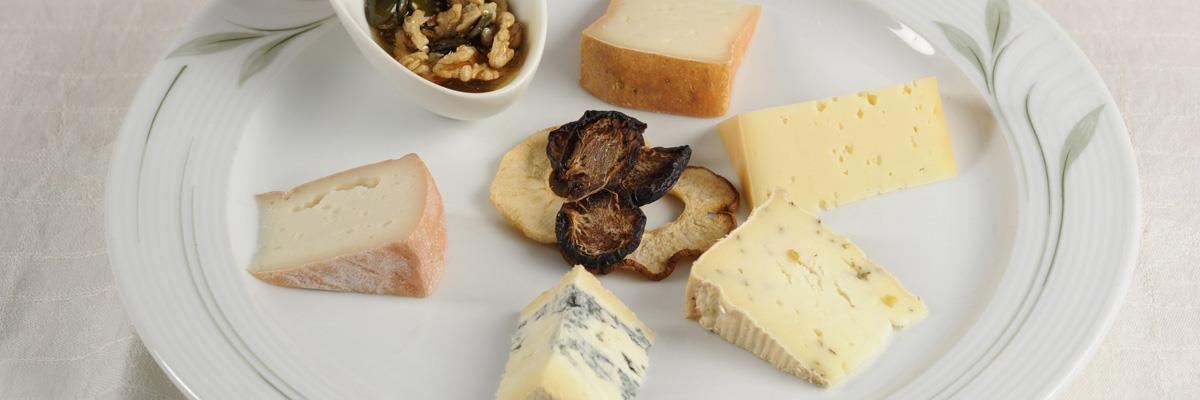 Cheese board with dried fruits and honeyed nuts