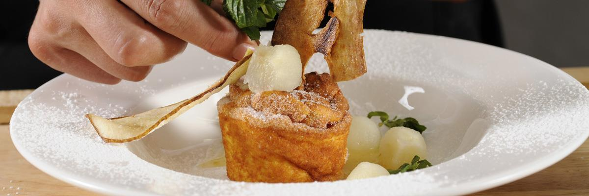 Quark soufflé with pear and grappa sauce
