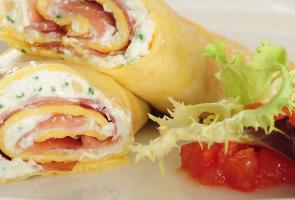 Wheat crêpes with speck and fresh cheese filling