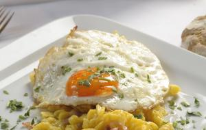 Egg spaetzle with onions, speck and sunny side up egg