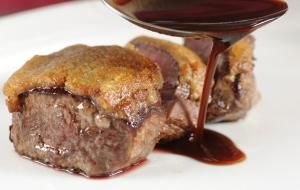 Honey-crusted venison medallions in a hearty game sauce